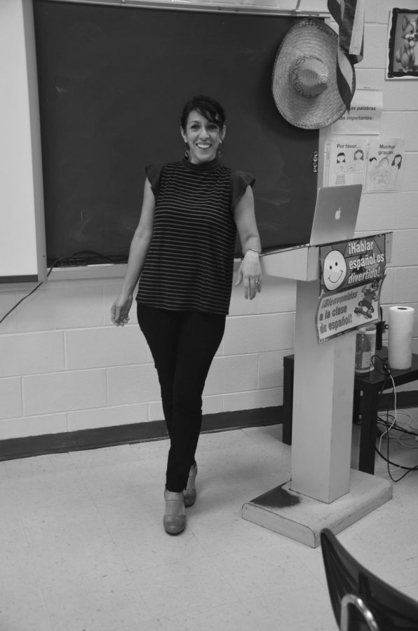 Mrs. Koutroulis poses for the camera while teaching class.