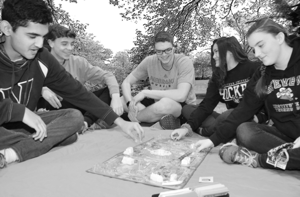 Juniors Jay Dave, Michael Carrington, Ryan Ems, Gemma Spina, and senior Rachel Necky play The Game of Life at Cook's campus at Rutgers.