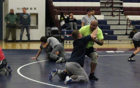 The grind begins for the wrestling team