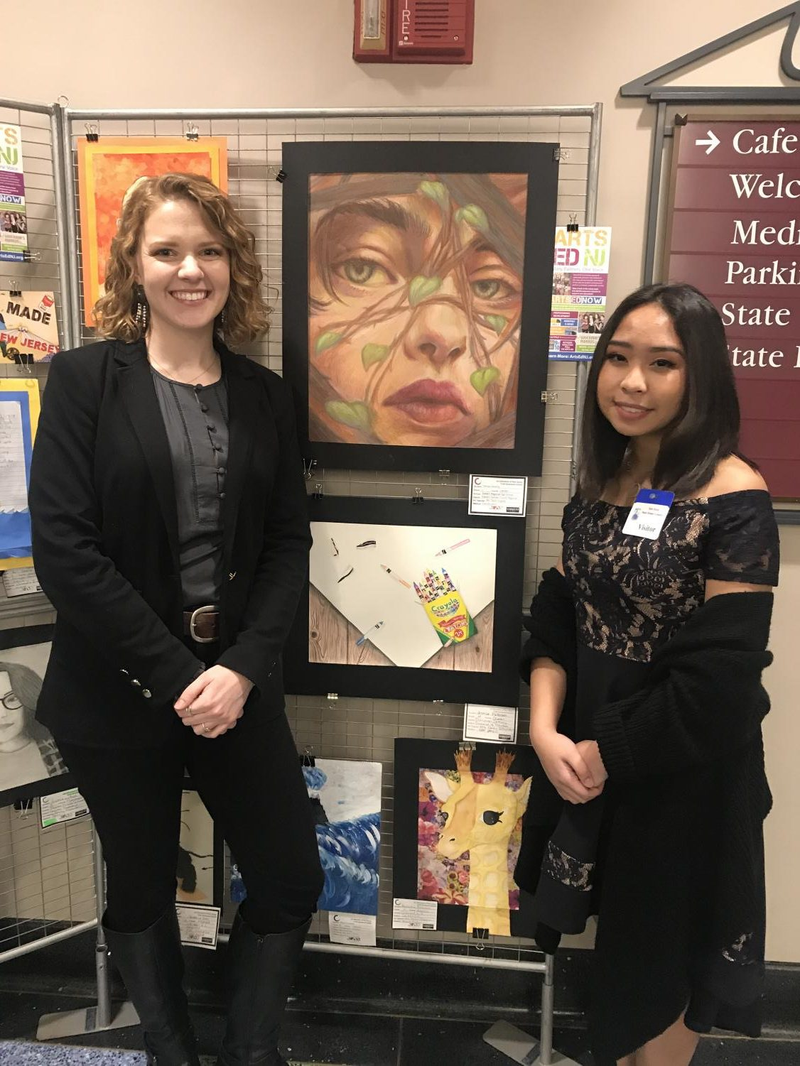 Art teacher Ms. Hughes poses with Denise Dacaney and the award-winning artwork