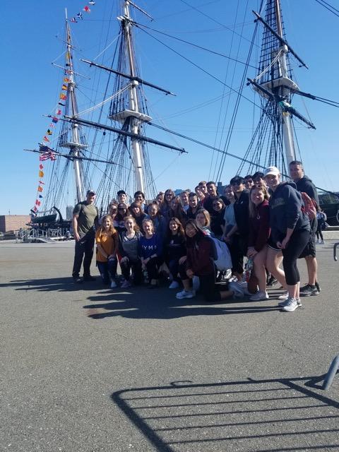 Rho+Kappa+members+pose+beside+Old+Ironsides%2C+docked+in+Boston%27s+harbor.+