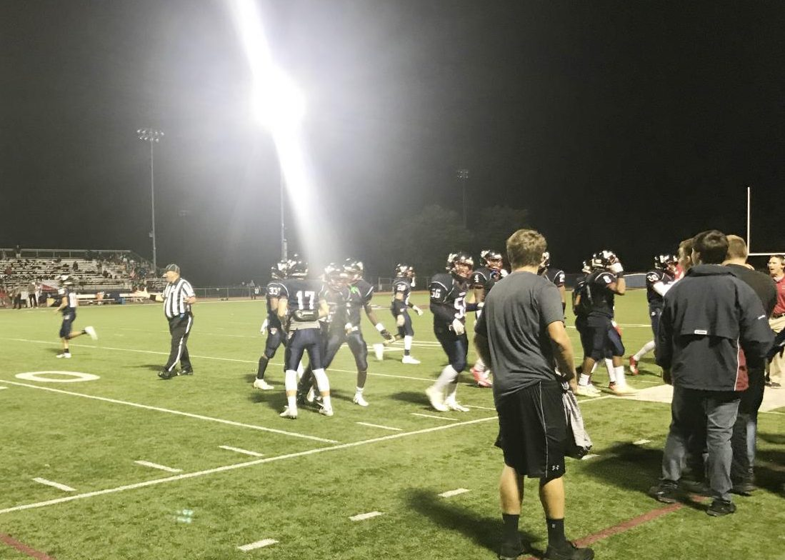 Eastern's varsity football team celebrates near the sideline following a touchdown. The Vikings romped their way to a 58-6 victory over Cherry Hill East.