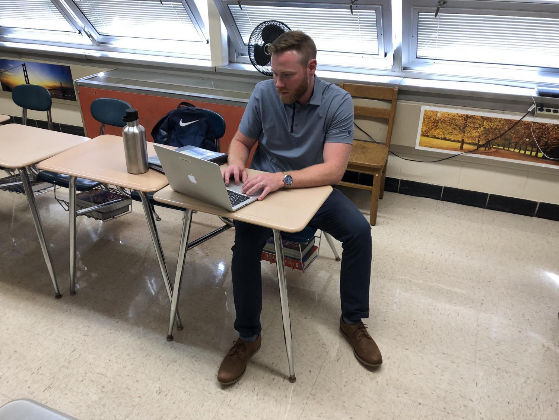 Mr. Adamonis reviews his schoolwork.