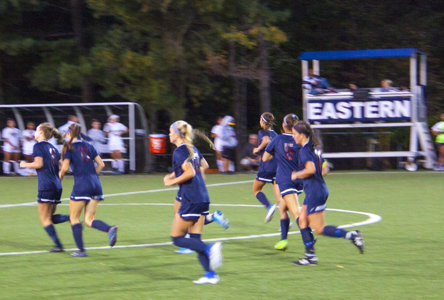 Captain Riley Tiernan and the stars of the Girls Soccer team return to midfield following a goal.