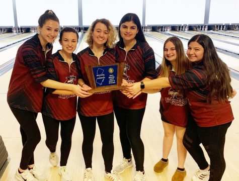Girls Bowling celebrates following their Group IV Sectionals victory.