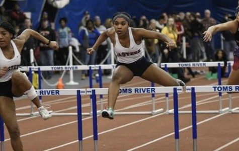 The Ash sisters compete in the 55-meter hurdles at the John Bennett Indoor Athletic Complex in Toms River, NJ.
