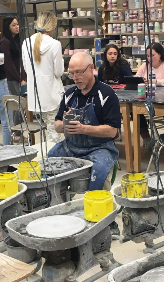 """Mr. Thomas works on a a clay cup. """"Art making and creative thought are different,"""" he said. """"It's holistic. There are challenges coming at you at all different times. I was determined to get a job to live off of in art."""""""