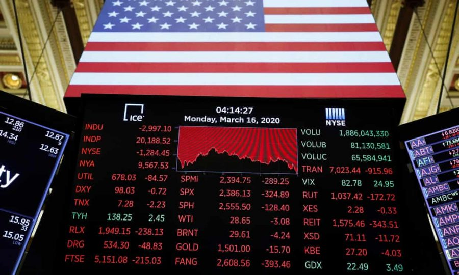 A price screen display is seen above the floor of the New York Stock Exchange.