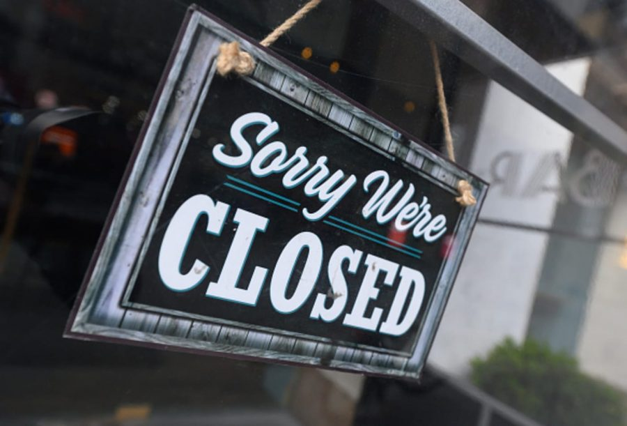 A 'Closed' sign outside of a store in Times Square.