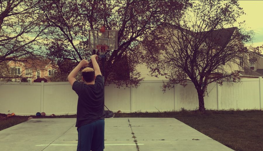 Gutterman enjoys embracing the beautiful weather of earth by shooting hoops outside.