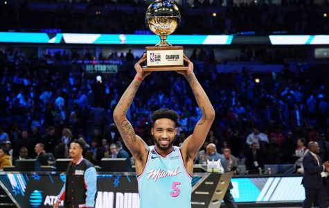 Derrick Jones Jr. holds up the 2020 Slam Dunk Contest trophy after defeating Aaron Gordon in a controversial battle.