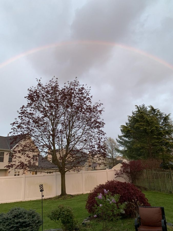 A rainbow appears in the sky after a heavy rainstorm in late April.