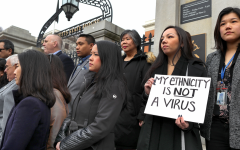 A group of Asian-Americans protest outside of the Statehouse in Boston, Mass. Hate crimes aimed at Asian communites across the U.S. have soared in recent months.