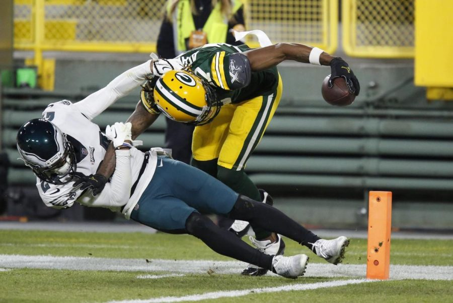 Green Bay wide receiver Davante Adams catches a touchdown pass from QB Aaron Rodgers in a 30-16 win over the Philadelphia Eagles.
