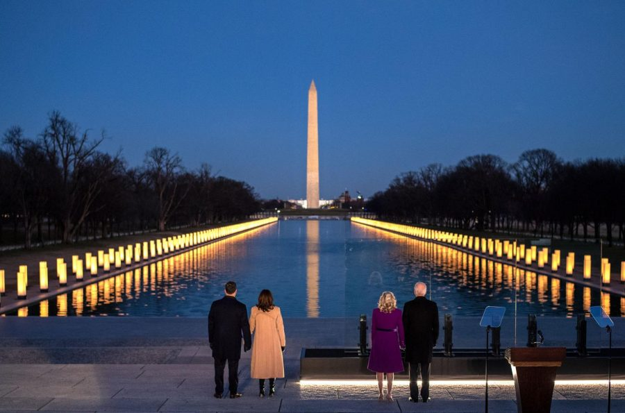The new President and Vice President, along with their spouses, stand before Washington Memorial on Inauguration night.