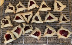 Hamantaschen are a traditional pastry for Purim that represent Haman's hat. Two popular flavors, pictured here, are cherry and chocolate chip.