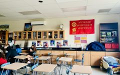 The Spanish Honor Society banner hangs in the soft glow of the classroom window.