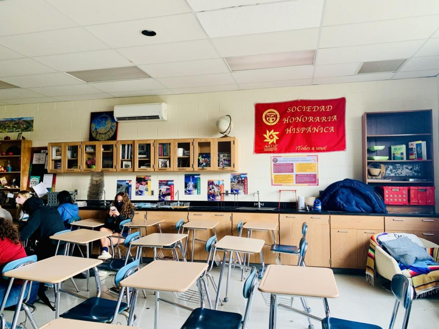 The+Spanish+Honor+Society+banner+hangs+in+the+soft+glow+of+the+classroom+window.