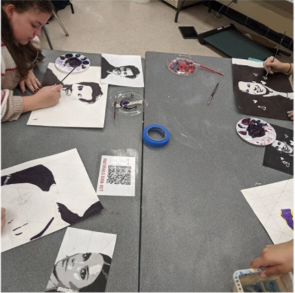Art students work on their portrait pieces.
